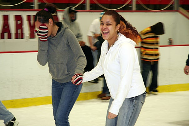 (Allston, MA - February 16, 2010) - Young residents of Allston-Brighton skate at Bright Auditorium during the 21st Annual Allston-Brighton Family Skate event at Harvard University. (left and right) Ileana Colon (17 years old) and Ashley Carrasquillo (16 years old) of Brighton enjoy the ice. Photo Lauren Marshall/Harvard University News Office
