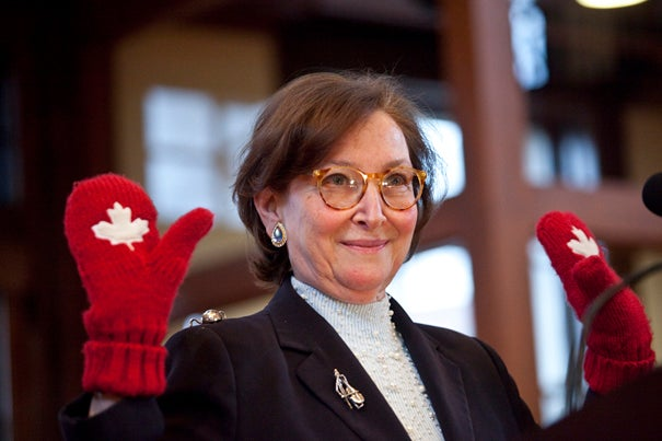 "Canadian Supreme Court Justice Rosalie Abella spoke at a Radcliffe Institute lecture March 1 on the importance of human rights: ""We need the rule of justice, not the rule of law."" Abella shows off her maple leaf mittens in honor of Canada's dramatic gold medal victory in Olympic hockey the previous day."