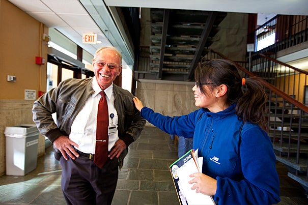 Students can't get through the door without Quincy House security guard Paul Barksdale getting to know them. Since he started in 2003, he has made a point of memorizing the name, face, and concentration of every incoming sophomore. Senior Janet He (right) sings his praises.