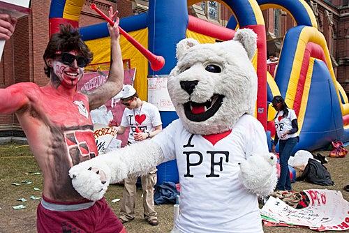 Body paint just won't do for Graham Frankel '12, as he do-si-dos for Pforzheimer House with polar bear mascot Cara Sprague '11.