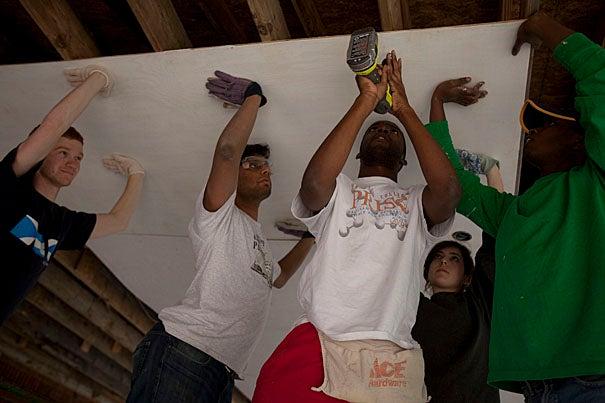 (Hayneville, AL - March 16, 2010) - From left, Marcel Moran, '11, George Thampy, '10, Nworah Ayogu, '10, Rachael Goldberg, '12 and Kennedy Mukuna, '12 join Harvard students from the Phillips Brooks House Association's Alternative Spring Break program to help rebuild the Hayneville Church of Christ in Hayneville, Alabama. Staff Photo Kris Snibbe/Harvard News Office