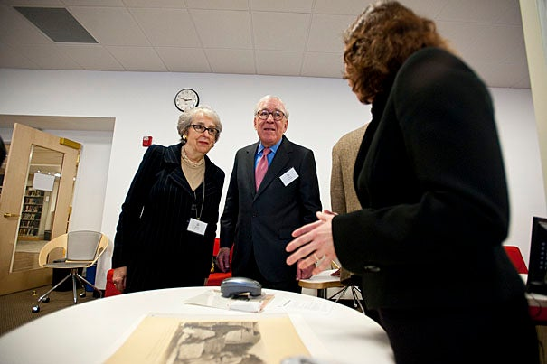 Harriet (left) and Paul Weissman '52 talk to Brenda Bernier, the Paul M. and Harriet L. Weissman Senior Photograph Conservator, about the analytical equipment used to identify the material makeup of objects.