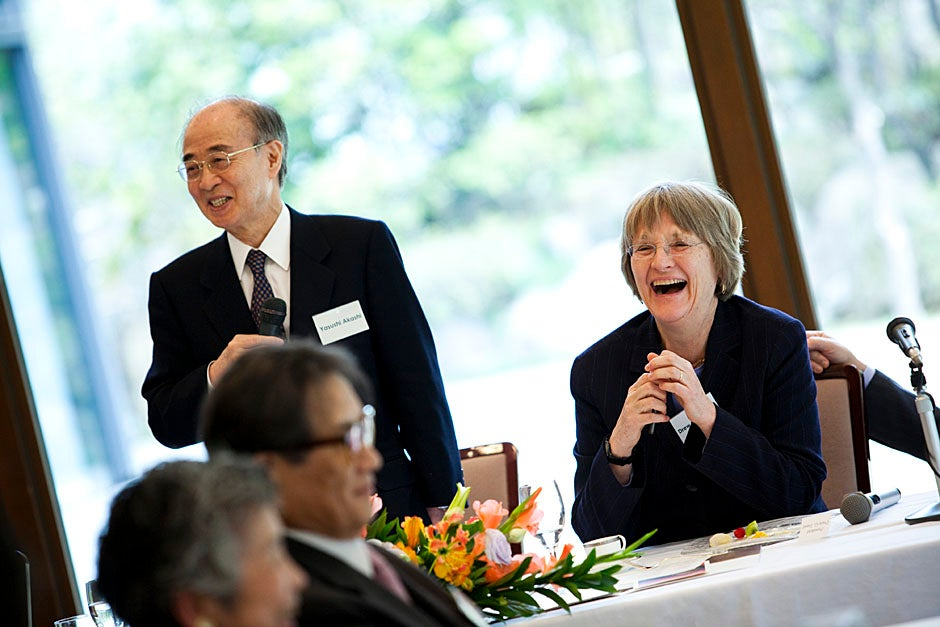 Yasushi Akashi (from left), the chairman of International House, and Drew Faust speak to a lunchtime gathering of university presidents. Stephanie Mitchell/Harvard Staff Photographer