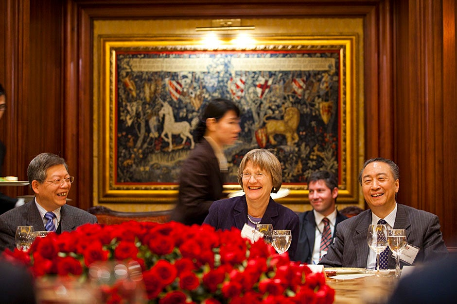 Yang YuLiang (from left), Faust, Madsen, and Zhang XinSheng speak during the lunch.  Stephanie Mitchell/Harvard Staff Photographer