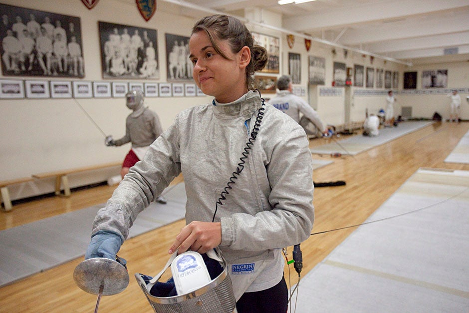 Elena Helgiu '13 of the Harvard fencing team practices inside the Malkin Athletic Center.   Kris Snibbe/Harvard Staff Photographer