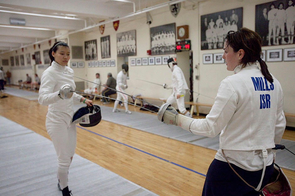 Noam Mills '12 (right) competed as a fencer in the 2008 Beijing Olympics, but here she practices with noble adversary Felicia Sun '13.  Kris Snibbe/Harvard Staff Photographer