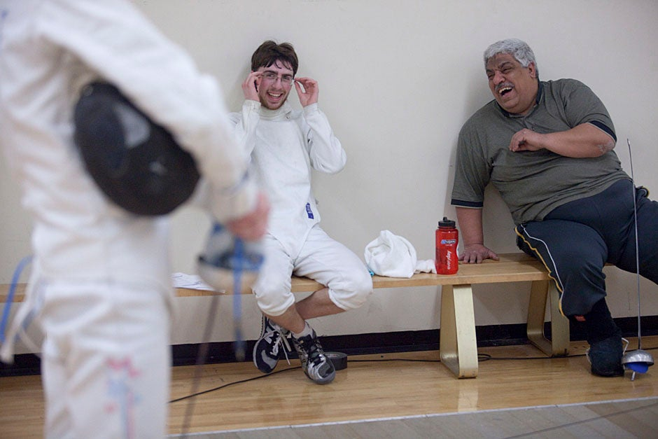 Benjamin Cohen '13 talks with coaching assistant Gamal Mahmoud during a Harvard fencing team practice inside the Malkin Athletic Center.   Kris Snibbe/Harvard Staff Photographer