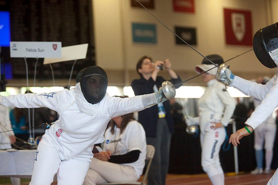 Noam Mills '12 (left) and Felicia Sun '13 spar during the NCAA Fencing Championships.  Kris Snibbe/Harvard Staff Photographer
