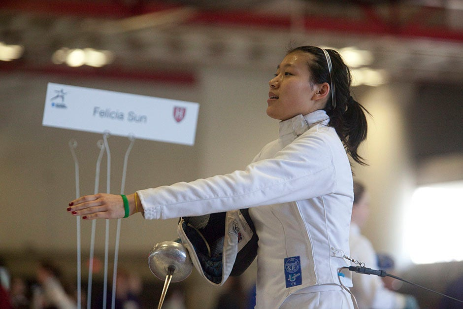 Felicia Sun '13 holds up her placard.  Kris Snibbe/Harvard Staff Photographer