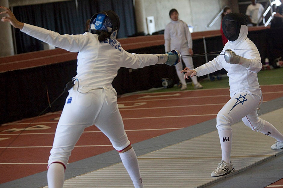 Kristin Howell (left) from Temple competes against Noam Mills '12. Kris Snibbe/Harvard Staff Photographer
