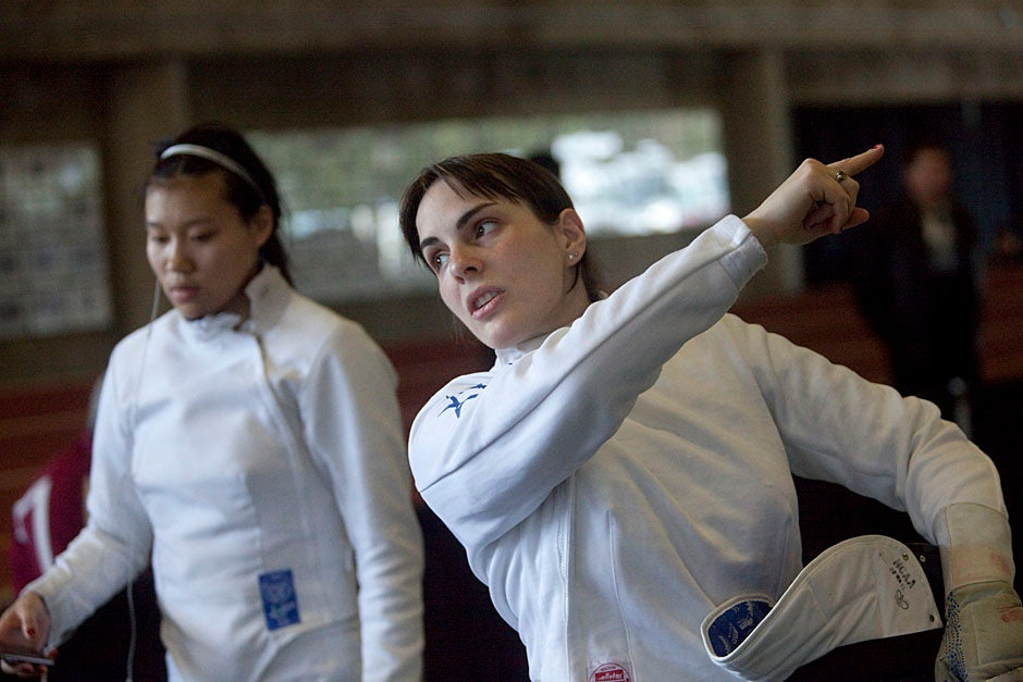 At the NCAA Fencing Championships, Felicia Sun '13 (left) and Noam Mills '12 are suited up in their protective gear and ready to roll.  Kris Snibbe/Harvard Staff Photographer