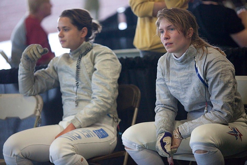 Elena Helgiu '13 (left) with teammate Caroline Vloka '12 wait and wonder at the NCAA Fencing Championships.  Kris Snibbe/Harvard Staff Photographer