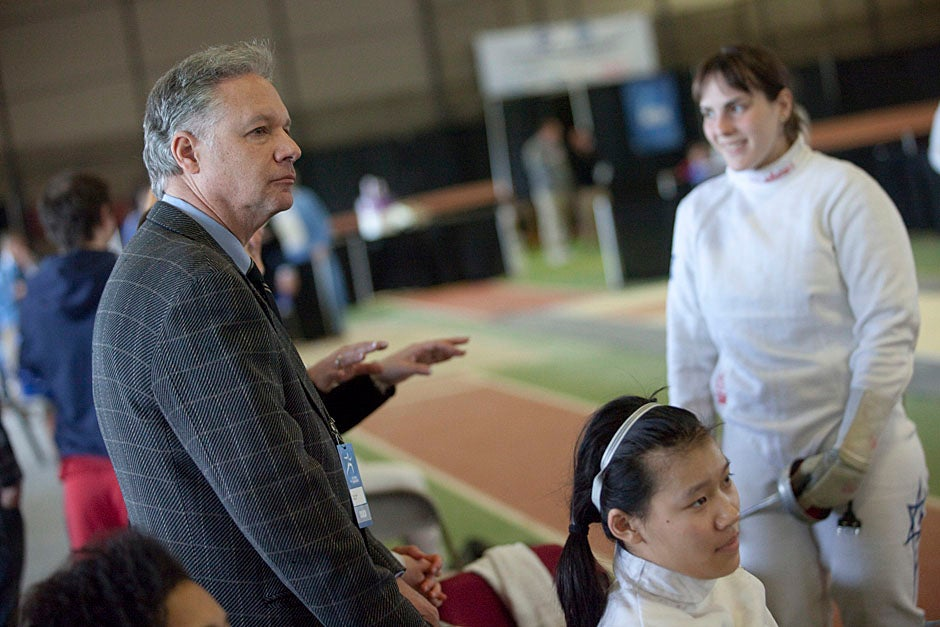 Fencing coach Peter Brand with Felicia Sun '13 (bottom right) and Noam Mills '12 (right) at the NCAA Fencing Championships. Kris Snibbe/Harvard Staff Photographer