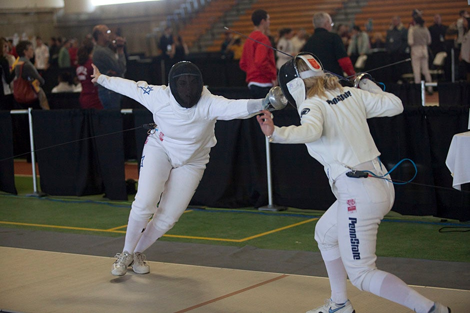 Noam Mills '12 (left) busts a move on Anastasia Ferdman from the Penn State fencing team.  Kris Snibbe/Harvard Staff Photographer