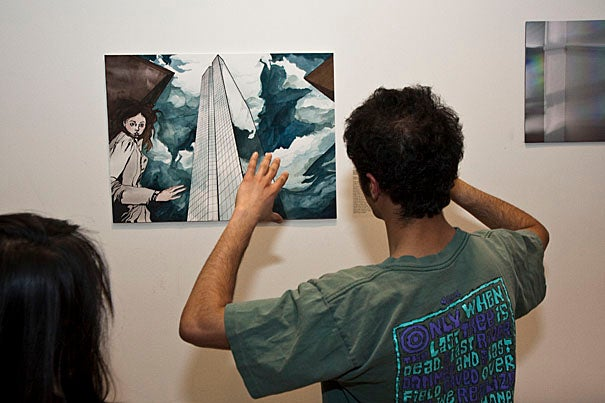 """(Cambridge, MA - April 1, 2010) -  Abhishek Bose-Kolanu '11 looks at """"Skyscape"""" by Shannon Mulshine at the opening at CGIS for """"Invisible Cities,"""" a student art show on display April 1-20, about journeys and cities both real and imagined,  focusing on the emotional aspects of experiencing a place. Organizers and co-creators of the show are Nancy Lin '11 and Anne Sawyier '11. Staff photo Jon Chase/ Harvard University News Office"""