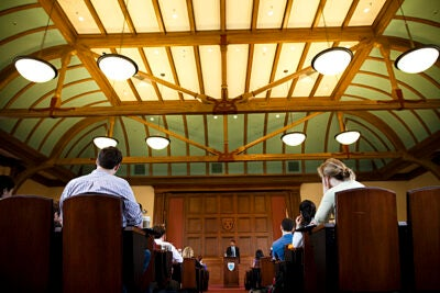 "(Cambridge, MA - April 7, 2010) - Dr. Atul Gawande speaks in the Ames Courtroom at Harvard Law School about his 2009 New Yorker article ""Hellhole."" Gawande discusses the effects of solitary confinement on the human brain, the mental and emotional toll on prisoners, and explores the question of whether the practice of solitary confinement is equivalent to torture. Atul Gawande (center) speaks speaks from the podium. Staff Photo Stephanie Mitchell/Harvard University News Office"
