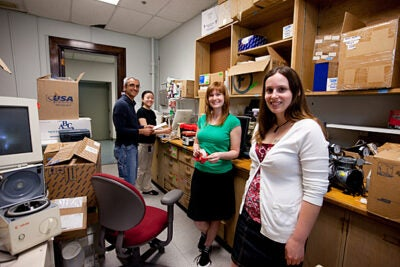 Samir Koirala (from left), Xun Wang, Emma Doud, and Amanda Nottke ship used laboratory equipment from HMS to overseas labs in need.