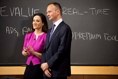 "CNBC ""Power Lunch"" visits Harvard Business School to create several live segments on Twitter's business plan with student and faculty experts in Hawes Hall. Michelle Caruso-Cabrera (left) reports the show and HBS associate professor Mikolaj Jan Piskorski provides expert advice."