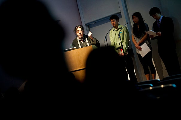 """Editors of three literary magazines banned or at risk in their home countries talk about the hard work of creative writing in oppressive regimes. """"The Living Magazine"""" event that takes place in the Sackler Museum auditorium features a panel of writers from China, Iran, and Burma. Bei Ling (left) speaks from the podium."""