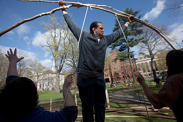 Clockwise from upper left: Mike Veino '13 (from left), Jonathan Perry of the Aquinnah Wampanoag tribe, and Tommy Miller '11 at the beginning stages of creating the wetu.