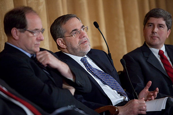 U.S. Rep. Michael Capuano (from left), Harvard Provost Steven Hyman, and Novartis senior director Phil Dormitzer shared the stage as panelists at a global health policy forum. Hyman noted that New England is well placed to play a key role in global health, with collaborations already established among universities, hospitals, and businesses.