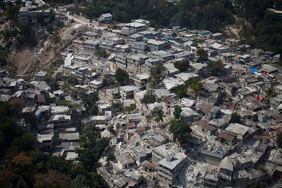 After the devastating 7.0 earthquake on Jan. 12, 2010 in Haiti, Harvard faculty and staff, including from the Harvard Humanitarian Initiative, the Medical School, and the School of Public Health, responded to the disaster. The Haitian capital of Port-au-Prince was destroyed in many places, as seen from this aerial shot.   Justin Ide/Harvard Staff Photographer
