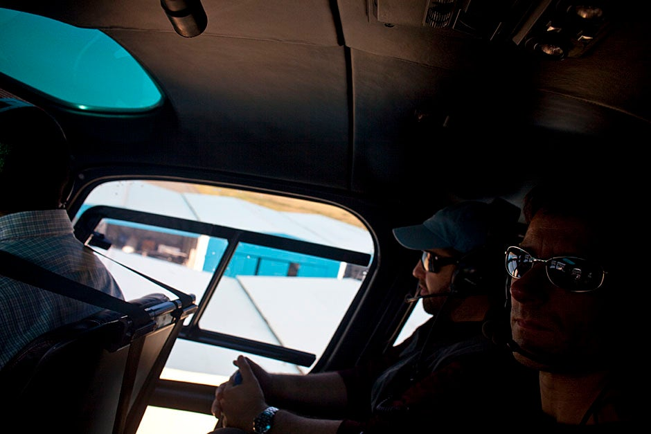 Michael VanRooyen (right) of the Harvard Humanitarian Initiative tours the disaster area in a helicopter. VanRooyen spent the first  day meeting political entities, including the president of Haiti and the vice president of the Dominican Republic.   Justin Ide/Harvard Staff Photographer