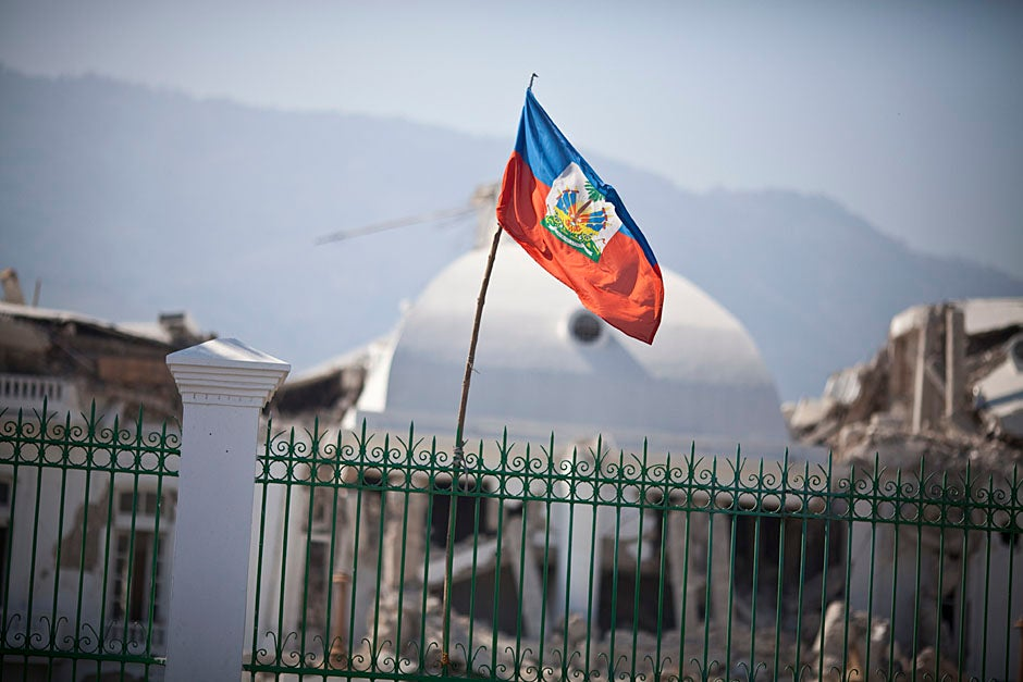 Outside the National Palace in downtown Port-au-Prince, the Haitian flag flies in front of the completely destroyed building.    Justin Ide/Harvard Staff Photographer