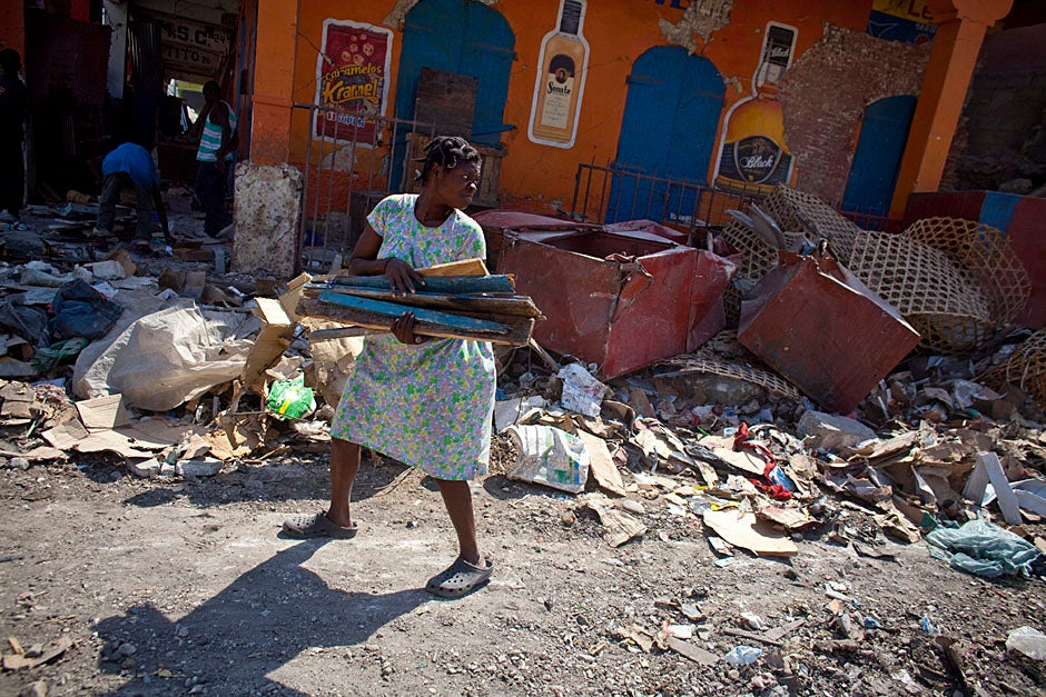 Many salvage whatever they can in the wasteland of downtown Port-au-Prince.    Justin Ide/Harvard Staff Photographer