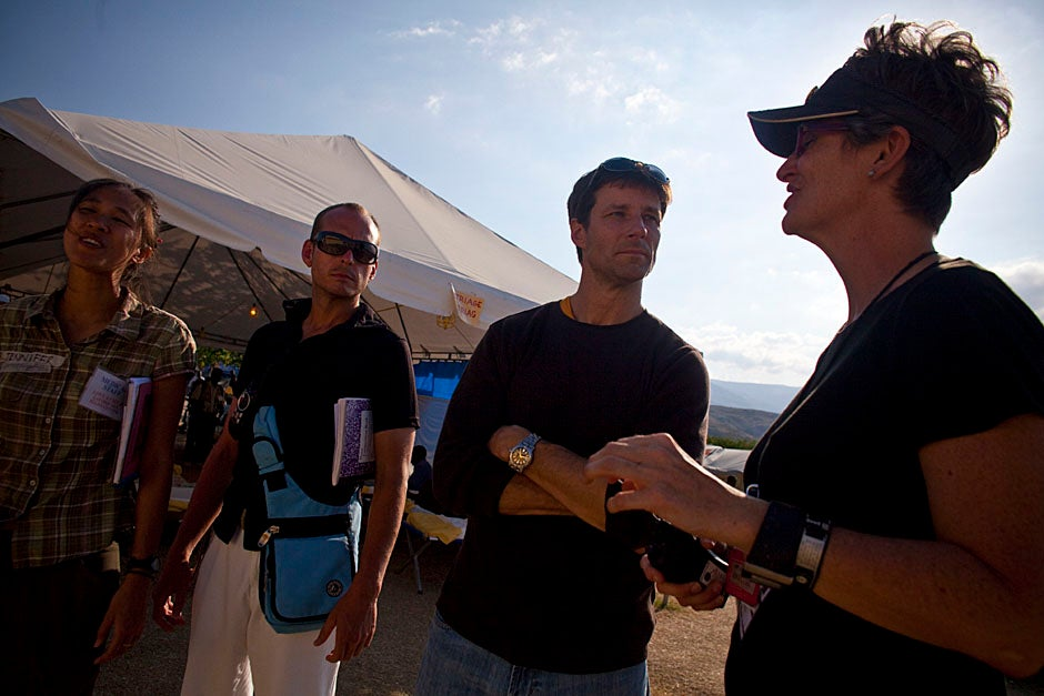 Jennifer Chan (from left), Christian Theodosis, Michael VanRooyen, and Hilarie Cranmer talk at the field hospital in Fond Parisen, Haiti.   Justin Ide/Harvard Staff Photographer