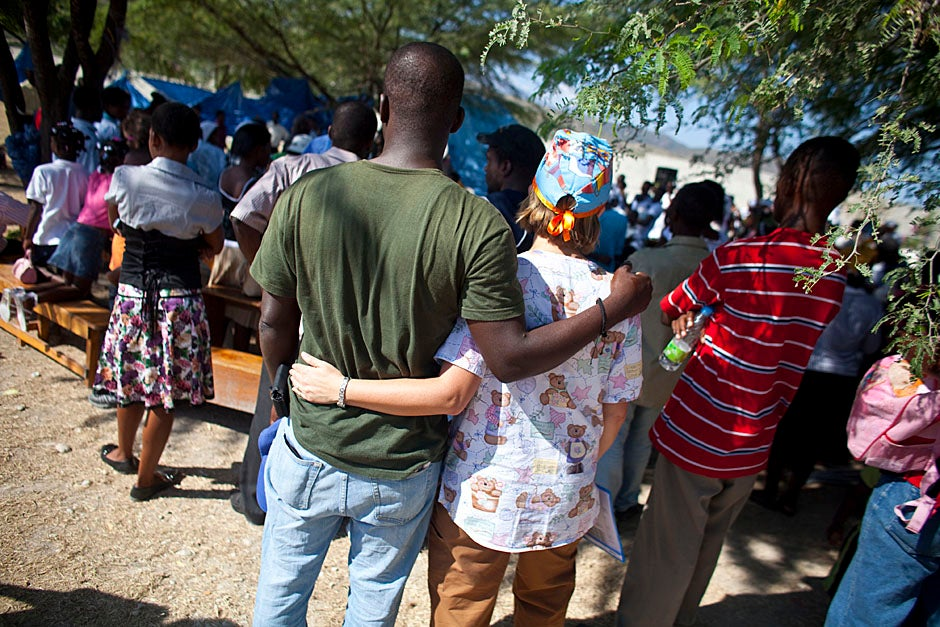 Staff and volunteers, as well as patients, attend the Sunday church service on the grounds of the field hospital.    Justin Ide/Harvard Staff Photographer