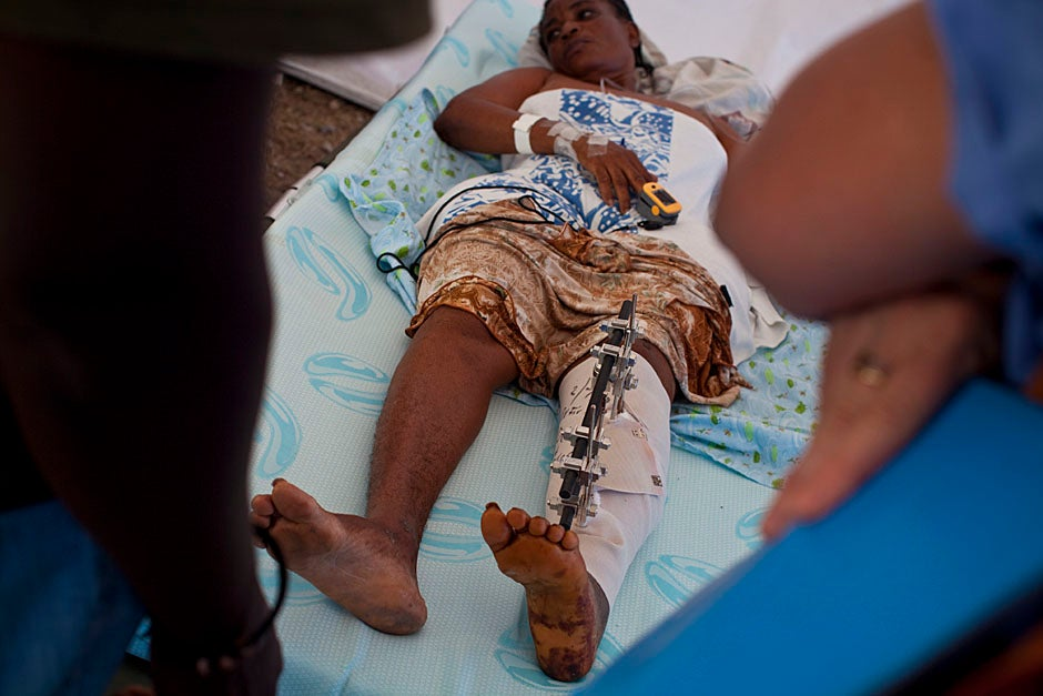 Doctors check on a patient with a crushed leg in the triage tent.   Justin Ide/Harvard Staff Photographer