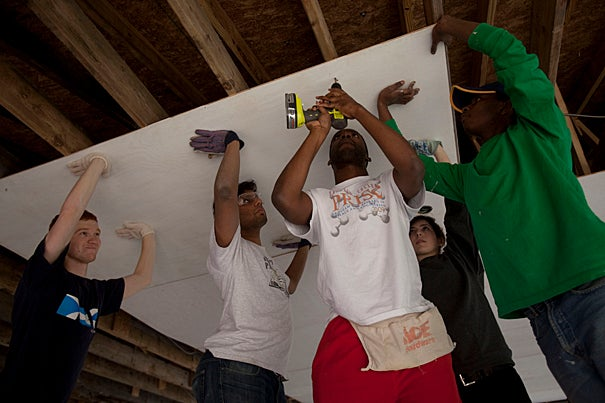 As part of alternative spring break, Harvard's Phillips Brooks House volunteers Marcel Moran '11 (from left), George Thampy '10, Nworah Ayogu '10, Rachael Goldberg '12, and Kennedy Mukuna '12 help rebuild a church in Alabama.