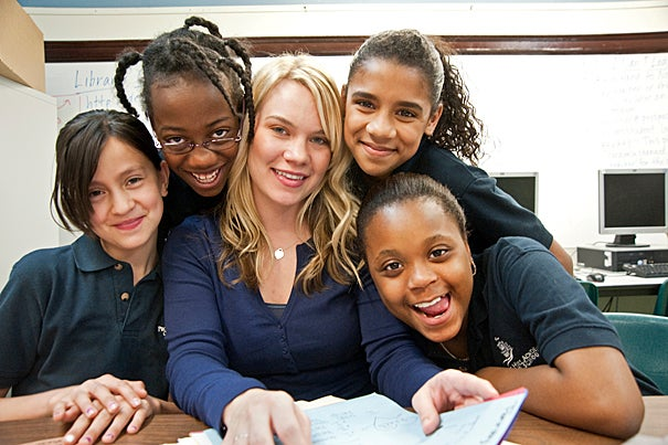 """Kim Snodgrass: """"I used my education as my savior. It was like my thing that I could always go back to, no matter what happened in my life."""" Snodgrass is pictured with students she teaches at the Prospect Hill Academy in Somerville, Mass."""
