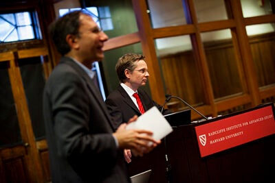 """Patterning in Nature,"" a daylong symposium in the Radcliffe Gymnasium, includes a lecture by Volker Springel, professor of theoretical astrophysics at Heidelberg Institute for Theoretical Studies in Germany, on dark energy and dark matter in the universe. Volker Springel (right) answers questions following his lecture."