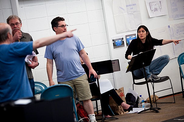 "Diane Paulus (below­) wraps up her first season at the helm of the American Repertory Theater. During a rehearsal for ""Johnny Baseball,"" playwright Richard Dresser (left facing), lyricist Willie Reale, and Paulus work out some details."