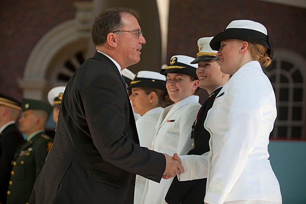 Michael G. Vickers, U.S. assistant secretary of defense for special operations, low-intensity conflict, and interdependent capabilities, congratulates Olivia Volkoff '10  during the ROTC commissioning ceremony.