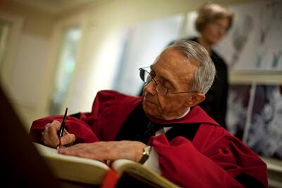 Justice David H. Souter signs the guest book inside Massachusetts Hall prior to the Morning Exercises at Harvard's 359th Commencement.