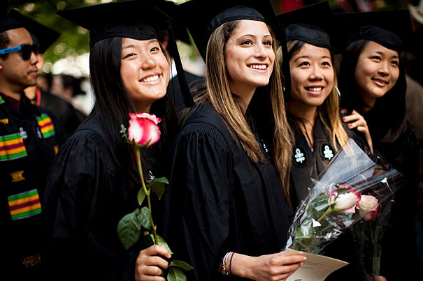 Graduates Cary Lin (from left), Paige Holtzman, Cindy Cheng, and Diane Choi pause for a photograph while processing into Tercentenary Theatre during the Morning Exercises.