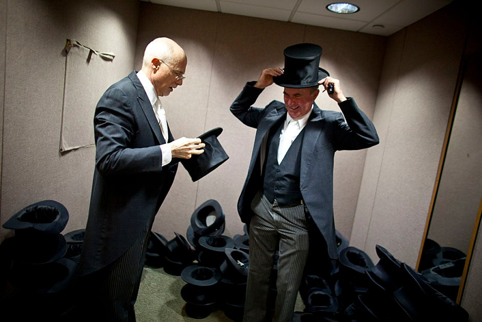 Class of 1969 members Jonathan Hubbard of Chicago (left) and Hugh Kelley of Wellesley size up their regalia prior to the morning festivities. Justin Ide/Harvard Staff Photographer