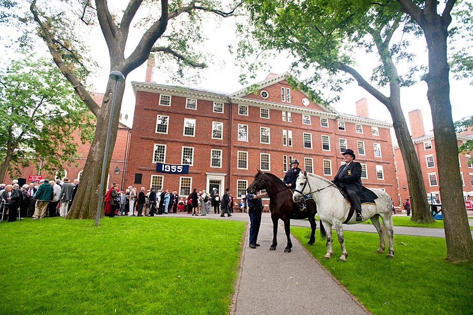 """Sheriff of Middlesex County James DiPaola rides a white horse into Harvard Yard. He is responsible for officially declaring the start of Commencement, decreeing, """"This meeting will be in order."""" Kristyn Ulanday/Harvard Staff Photographer"""