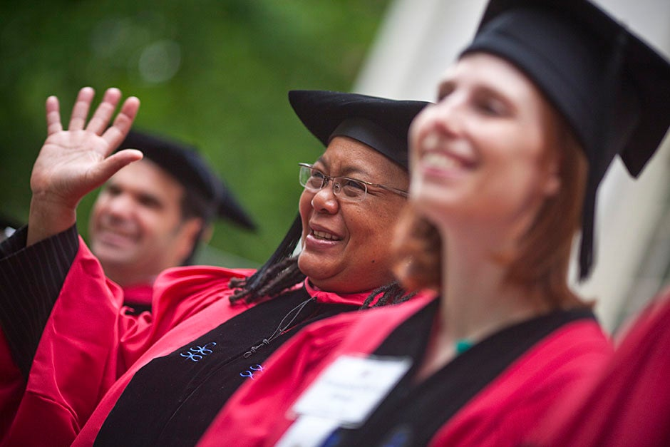 Harvard College Dean Evelynn Hammonds waves to graduates from the steps of University Hall as they gather for the senior service inside the Memorial Church. Justin Ide/Harvard Staff Photographer