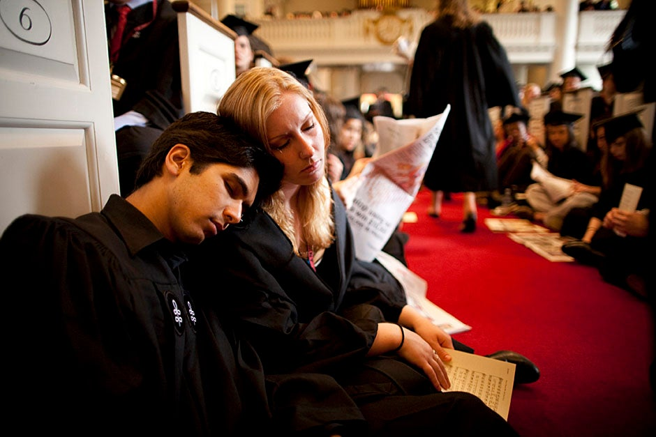 Suveg Pandey (left) and Whitney Williams fit in a quick nap before the service begins in Memorial Church. Stephanie Mitchell/Harvard Staff Photographer