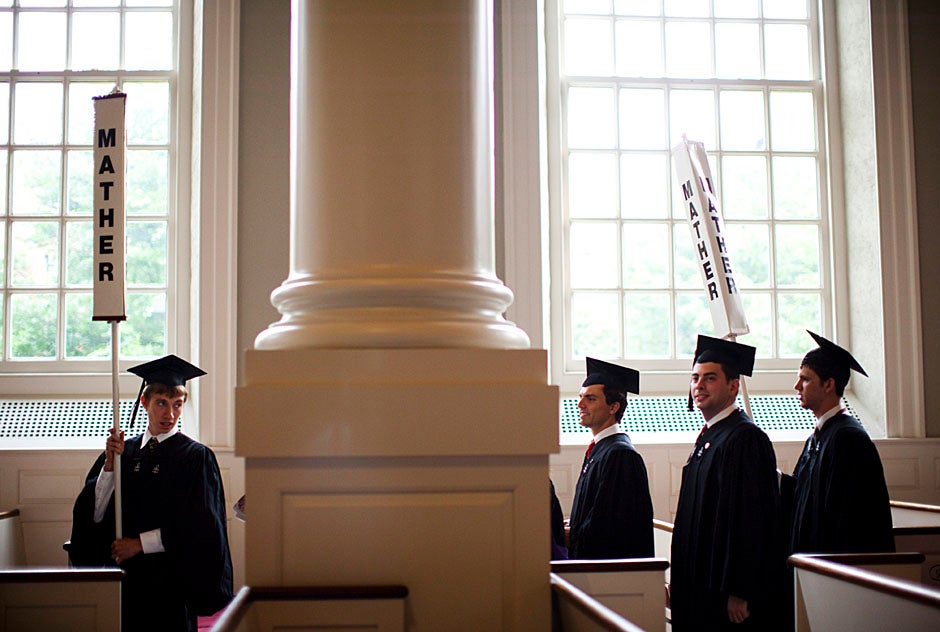 Graduates exit the Memorial Church following the morning service for seniors. Stephanie Mitchell/Harvard Staff Photographer