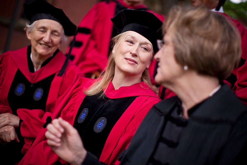 Honorary degree recipients Baroness Onora O'Neill of Bengarve (from left) and Meryl Streep listen to Harvard President Drew Faust just prior to the procession. Justin Ide/Harvard Staff Photographer