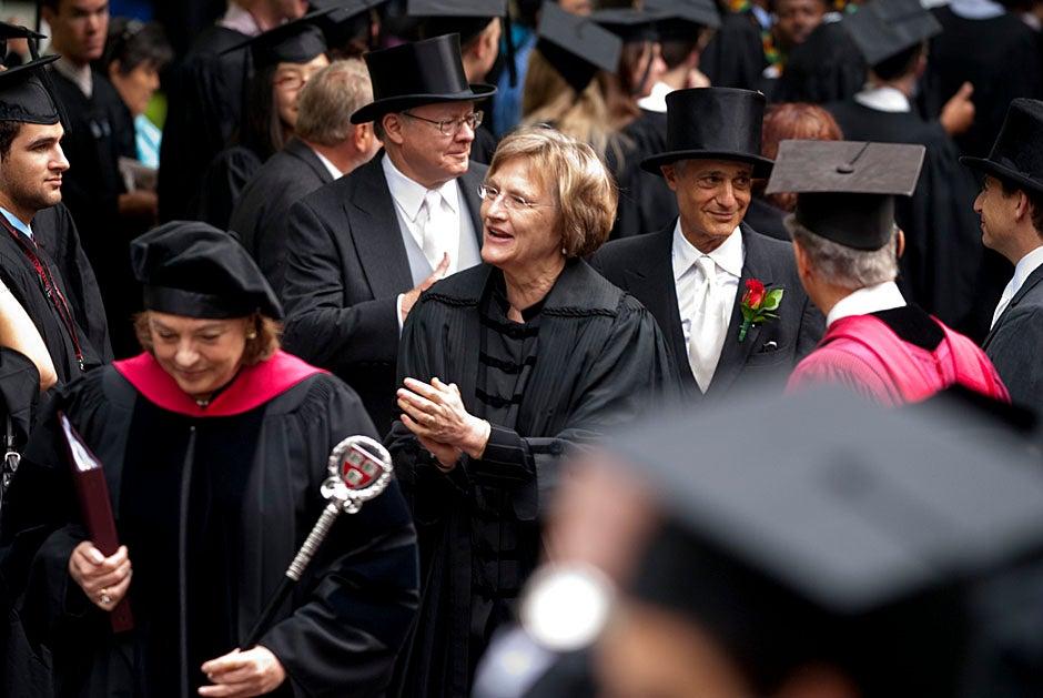 Harvard President Drew Faust walks through lines of graduating students in Harvard Yard. Kristyn Ulanday/Harvard Staff Photographer