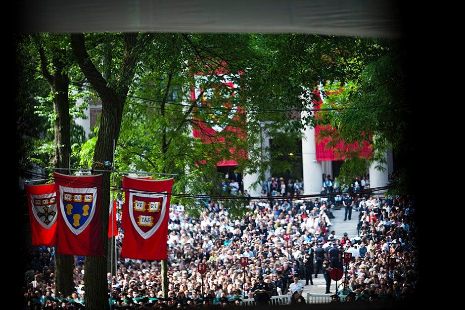 Graduates and their families fill Tercentenary Theatre. Stephanie Mitchell/Harvard Staff Photographer