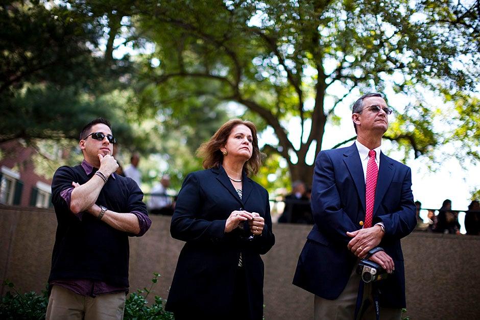 Jason Aaron Katz (from left), Rebecca Hart, and Ricky Hart watch the Morning Exercises. Stephanie Mitchell/Harvard Staff Photographer