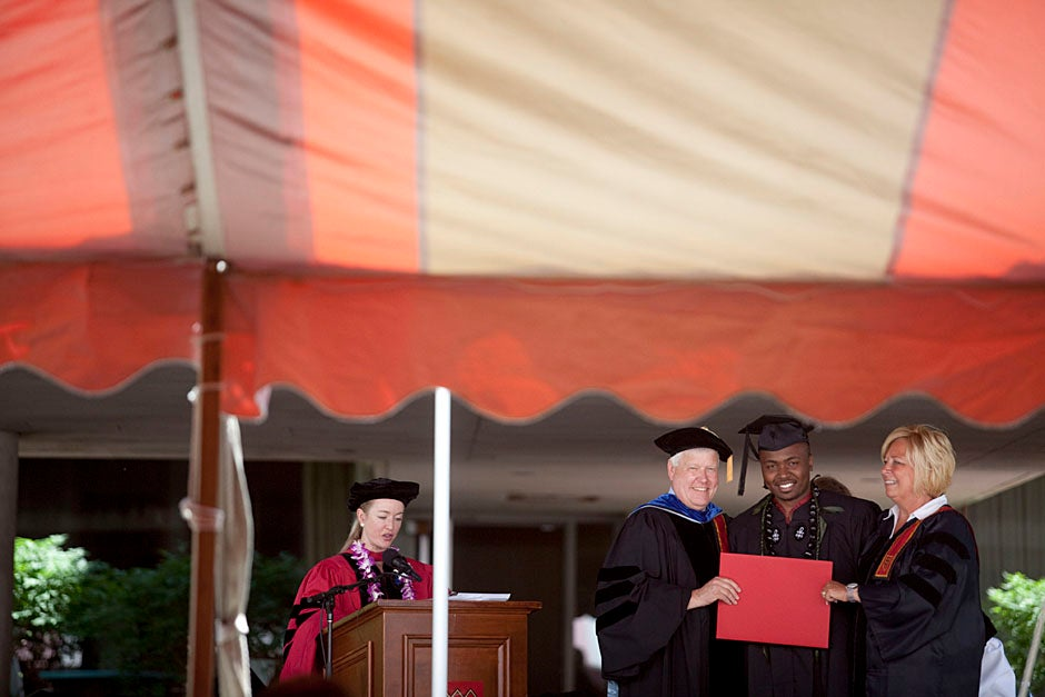 Stephen Lwendo '10 receives his diploma from Quincy House co-masters Lee and Deborah Gehrke.  Kris Snibbe/Harvard Staff Photographer