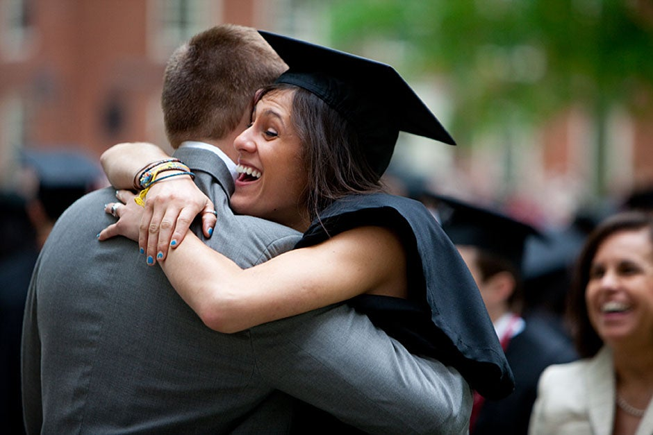 Anne Austin '10 greets her friend and fellow Hasty Pudding crew member, Quinn Carson, who unexpectedly showed up to see her graduate. Rose Lincoln/Harvard Staff Photographer